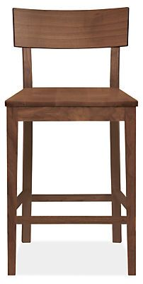 The petite size of our Doyle stool makes it ideal for smaller spaces or extra seating needs, but the stately silhouette means it looks right at home in a formal dining room.