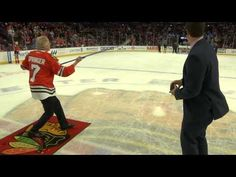 Jerry Springer shot the puck at Friday's game against the Colorado Avalanche.