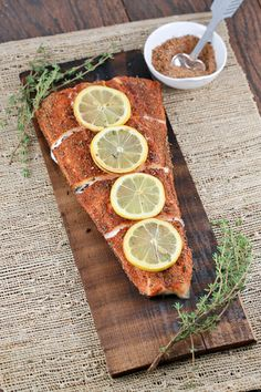 Grilled Cedar Plank Salmon Fillet Recipe - a flavorful herb spice mix is a delicious and healthy way to enjoy this tender a flaky fish. The cedar plank infuses an earthy and smoky element to the salmon dish. | jessicagavin.com