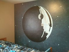 Star Wars bedroom. Completed with glow in the dark stars & black shelving