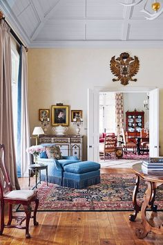 Heraldic accessories decorate the otherwise simple stylish drawing room of Mount Algidus.