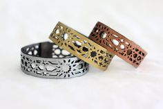 These are stunning! 3 Geometric Laser cut Metallic Leather Bracelets by stylehybrid, $75.00