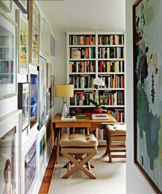 awesome study/lounge area--- comfy chairs, natural light, framed travel photographs, tall colorful bookcase and a world map.