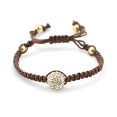 The Eastern prayer bracelets that have swept Western fashion are given a gorgeous turn in this eye-catching version. A glimmering sphere of black pave' crystals is stunningly set off by a rich brown,                                                                                                                                                                                  More