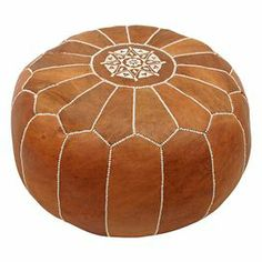 """Brimming with exotic appeal, this handcrafted leather pouf showcases embroidered Moroccan-inspired detailing.   Product: PoufConstruction Material: LeatherColor: BrownFeatures: Made in MoroccoDimensions: 14"""" H x 20"""" Diameter"""