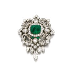 FROM A GERMAN PRINCELY COLLECTION: Emerald and diamond brooch/pendant. Of scroll design, set with a cabochon emerald, single-, brilliant-cut and pear-shaped diamonds.