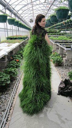 """Stevie Famulari's new Green Line series — currently on view at the Plains Art Museum in Fargo, North Dakota — has fashioned five """"elegant"""" garments (an opera gown, an asymmetrical gown, a lawn coat, a."""