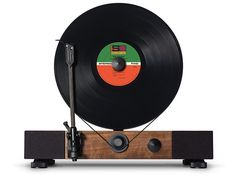 The Floating Record is a high-performance turntable that plays your records vertically / 'Floating Record - Walnut'