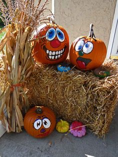 Painted Pumpkins! We used these to decorate our front porch. Add a straw bale and some corn stalks for fun!