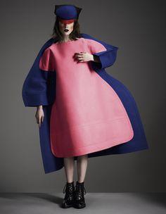 Felt dress, by Comme des Garçons. Leather boots, by Topshop Unique. Felt, perspex and crinoline hat by Noel Stewart.
