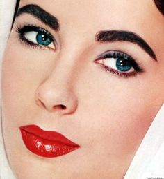 Elizabeth Taylor , love her thick natural looking eyebrows and red lips... beautiful make up in vintage 1940s and 1950s
