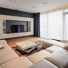 casual tv room with sectional couches — home designing