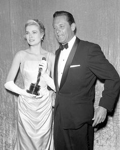 Grace Kelly received her Oscar for 'The Country Girl' from costar William Holden, 1955.