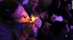 A man smokes a joint during the official opening night of Club 64, a marijuana social club in Denver, on New Year's Eve 2012. Voters in <a href='http://www.cnn.com/2012/11/07/politics/marijuana-legalization/index.html'>Colorado and Washington state</a> passed referendums to legalize recreational marijuana on November 6, 2012.