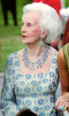 Princess Lilian of Sweden wearing a turquoise and diamond suite.  She was born in Wales and was a former fashion model.  She died in March 2013 at age 97.
