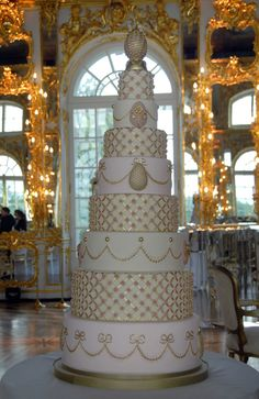 www.peggyporschen.com  Russian Wedding Cake.  Amazing time/design work.  Wish it had been taken from another angle.  Bad angle makes it look off center, but it is not.
