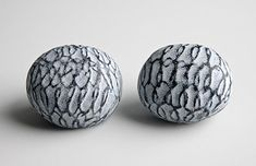 Jessica Turrell  Brooches: Hollow-form series 2010  Vitreous enamel on electroformed copper, oxidized silver