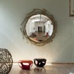 Love the idea of this mirror. Probably wouldn't be hard to come up with a nice display if you could find an old bubble mirror.