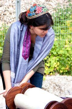 Israeli woman prepares to open the Torah scroll.