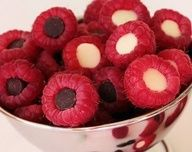 Stuff raspberries with chocolate kisses and you've got a treat for Valentines day, or any day. pinned with Pinvolve