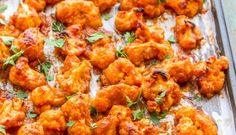 Wanna guess what these drooly buffalo wings are made of? Get this: Cauliflower! Theyre the perfect bite for anyone. Vegan Cauliflower Wings, Baked Buffalo Cauliflower, Healthy Snacks, Healthy Eating, Healthy Recipes, Food Videos, Yummy Food, Stuffed Peppers, Baking