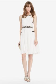 Straight from the Spring runway, the DVF Letty is all about contrast. Ethereal chiffon mixes with python-stamped leather, and a high neckline keeps the polish while a deep v-neck back makes a dramatic exit. With decorative chiffon covered buttons and invisible side zip. Falls to below the knee. Fits true to size.