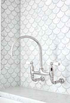 Our laundry - we just love these fish scale tiles... thanks to Art of Tiles Newtown, The English Tapwear Company & Cape Cod Home Additions
