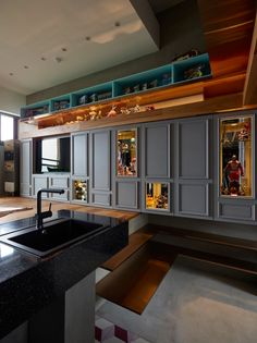 A Taipei House Designed for Toy Building and Collections  Designed for two creative people, the interior had to accommodate their shared love of toy collecting and LEGO building with plenty of display space and room to build their figures.