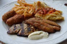 A typically bajan buffet ... fry fish, grill fish,macaronie pie,fishcakes. http://on.fb.me/17smUl5