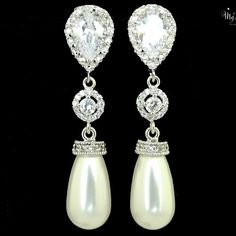 Silver Swarovski crystal drop Pearl earrings surrounded by small cubic zirconia stones