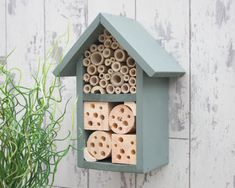 Two Tier Insect and Bee Hotel in 'Muted Clay'. Your garden will soon be buzzing with this great bug house. This insect habitat is ideal for hanging in a sheltered garden, house wall or orchard. It is designed primarily to be used by solitary bees such .