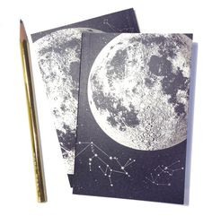 Full Moon Journal, blank sketchbook, metallic silver recycled paper, small pocket size, luna constellation design with starts and animals. $10.00, via Etsy.