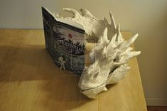 """Danish American artist Victoria certainly paid her respects to the epic book """"Hobbit"""" by crafting a gorgeous paper sculpture of the great dragon Smaug out of its Danish release"""