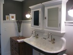 April Foster's farmhouse kid's bath.  Used old dressers as cabinetry