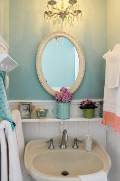 Aiken House and Gardens Perfect Shabby Chic Aqua bathroom that is my DREAM bathroom! I love the colour, the panelling on the walls, the lilacs everywhere and the crochet trim flowers.