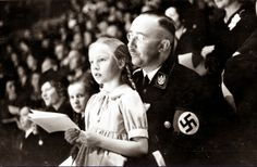 Gundrun with her father, Heinrich Himmler, 1938  If you were on the outside looking in and you had never heard of a Nazi before, who would be able to tell the horrific acts and inhumane preaching being advocated in this photo? It's chilling.