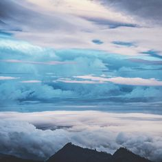 Cloudscape at Dawn in Indonesia . #abovetheclouds #cloudscape #mtrinjani #rinjani #volcano #lombok #indonesia #hiking #hikingadventures #mountains #adventureawaits #awesomeearth #places #landscape #lifeofadventure #liveoutdoors #wearestillwild #travel #travelawesome #travelphotography #travelstoke #outplanetdaily #exploretocreate #peoplescreatives #wanderlust . Taken Jun. 2016