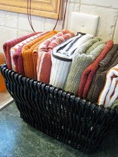 """Dishcloths in a basket beside the sink -- I've done this forever and it's sooo much better than them being in the """"junk drawer"""" or on the windowsill."""