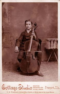 1885, [cabinet card, portrait of a child playing his cello]