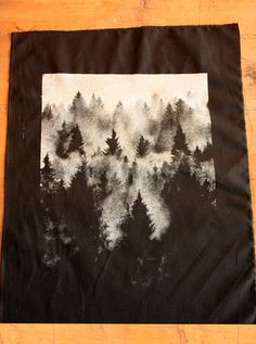 Hand pulled, DIY screen print back patch of a pine forest drenched in fog. Suitable for both nature loving crusties and goths alike. Single