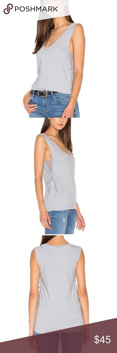 Pam & Gela Side Lace Up V Neck Tee Grey. NWOT. Pam & Gela Side Lace Up V Neck Tee Grey. NWOT! Slug Knit fabric. Side Lace up closures. Twisted neckline. Poly, cotton, rayon blend. Size XS. Pam & Gela Tops Tank Tops