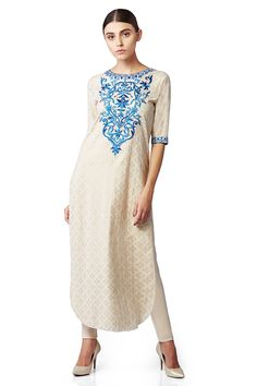 An alluring kurta in flesh colour, with beautiful motifs in thread embroidery that emphasize the yoke, giving this outfit a touch of glamour. INR 9,990.00