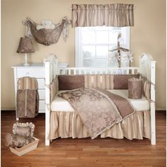 Bring elegance and sophistication to your nursery. The Cora Collection from BananaFish features a mocha floral jacquard with taffeta and silky stripe fabric.