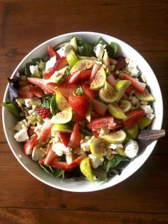 Baby greens with fresh figs, strawberries, goat cheese and toasted pine nuts.