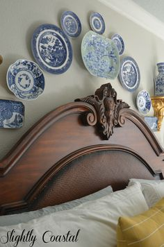 Chinoiserie blue and white willow plates above master bed