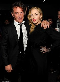 SEAN PENN, attired in a black suit, black tie and white shirt, didn't hesitate to smile as he put his arm around his ex-wife, MADONNA.  -- September 2013