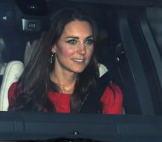 """The Duchess arrives at the annual pre-christmas family lunch at Buckingham Palace wearing her bespoke red Alexander McQueen dress seen at the Queen's Diamond Jubilee, and Catherine Zoraida """"Double Leaf"""" earrings."""