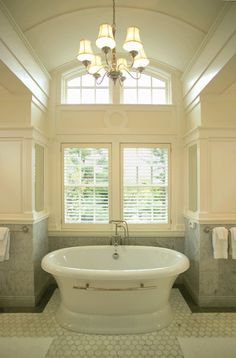 Master Bath with Barrel Vaulted Ceiling, Free-standing Spa Tub, and Creamy White & Gray color scheme