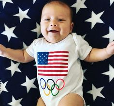 Michael Phelps' Son Boomer Sports Olympic Onesie - http://site.celebritybabyscoop.com/cbs/2016/08/03/michael-olympic-onesie #MichaelPhelps