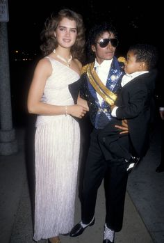 "Michael Jackson arrives at the 26th GRAMMY Awards in 1984 with actress Brooke Shields and ""Webster"" star Emmanuel Lewis"